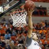 OSU\'s Cezar Guerrero (1) lays in a shot over Texas A&M\'s Ray Turner (35) in the first half of a men\'s college basketball game between the Oklahoma State University Cowboys and Texas A&M University Aggies at Gallagher-Iba Arena in Stillwater, Okla., Saturday, Feb. 25, 2012. OSU won, 60-42. Photo by Nate Billings, The Oklahoman