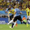 Photo - FILE - In this June 28, 2014 file photo, Colombia's James Rodriguez shoots to score his team's first goal during the World Cup round of 16 soccer match between Colombia and Uruguay at the Maracana Stadium in Rio de Janeiro, Brazil. Rodriguez provided one of the best goals of the tournament with a swivel-and-volley move that left fans gasping in delight. (AP Photo/Antonio Calanni, File)