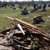Volunteers clean the Moore Cemetery of debris following this week\'s violent tornado. PHOTO BY ED GODFREY, THE OKLAHOMAN