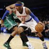 Photo - Boston Celtics forward Paul Pierce (34) defends as New York Knicks forward Carmelo Anthony (7) drives to the basket in the first half of their NBA basketball game at Madison Square Garden in New York, Monday, Jan. 7, 2013. (AP Photo/Kathy Willens)