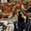 Oklahoma State\'s Marcus Smart (33) loses the ball against Gonzaga\'s Kyle Dranginis (3) and Guy Landry Edi (10) as Sam Dower (35) looks on during a men\'s college basketball game between Oklahoma State University (OSU) and Gonzaga at Gallagher-Iba Arena in Stillwater, Okla., Monday, Dec. 31, 2012. Photo by Nate Billings, The Oklahoman