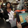 Ceejay Johnson, 48, of Southfield, Mich., gives her Powerball ticket numbers at Andrews Downtown in Detroit, Wednesday, Nov. 28, 2012. Tonight\'s Powerball total is an estimated 500 million dollar jackpot. Johnson who normally doesn\'t play the lottery said,