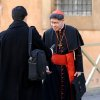 Cardinal Luis Antonio Tagle, of the Philippines, right, arrives for a meeting, at the Vatican, Monday, March 4, 2013. Cardinals from around the world have gathered inside the Vatican for their first round of meetings before the conclave to elect the next pope, amid scandals inside and out of the Vatican and the continued reverberations of Benedict XVI\'s decision to retire. (AP Photo/Andrew Medichini)