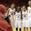 Photo - OU seniors, from left, Portia Durrett (31), Aaryn Ellenberg (3), Morgan Hook (10) and Nicole Griffin (4) have their picture taken by photographer Ty Russell after a women's college basketball game between the Oklahoma Sooners and Texas Tech at Lloyd Noble Center in Norman, Okla., Monday, March 3, 2014. OU won 87-32. Photo by Nate Billings, The Oklahoman