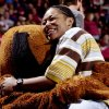 MASCOT: Former University of Oklahoma women\'s college basketball player Rosalind Ross gets a hug from Top Daug during the OU-Texas game this past week. Ross is now a WNBA player. Oklahoman staff Photo by Ty Russell.