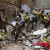 Photo - Rescue workers clear debris at the site of a building collapse in New Delhi, India, Saturday, June 28, 2014. A dilapidated building collapsed in the Indian capital on Saturday, killing at least seven people as rescuers searched for others believed to be trapped. (AP Photo/Altaf Qadri)