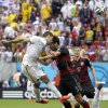 Germany\'s Mats Hummels pushes off United States\' Clint Dempsey as he heads the ball at the Germany goal during the group G World Cup soccer match between the USA and Germany at the Arena Pernambuco in Recife, Brazil, Thursday, June 26, 2014. (AP Photo/Ricardo Mazalan)