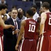 Photo - Oklahoma head coach Lon Kruger talks to his team during a timeout in the second half of an NCAA college basketball game in the BB&T Classic against George Mason, Sunday, Dec. 8, 2013, in Washington. Oklahoma won 81-66. (AP Photo/Alex Brandon)