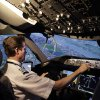 Photo -  American Airlines pilot Bill Elder, the airline's fleet training manager on the Boeing 787 Dreamliner, banks sharply to the left over the Queens and Manhattan boroughs of New York in a Boeing 787 flight simulator in Fort Worth, Texas. AP Photo   LM Otero -  AP