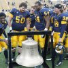 Kent State\'s Dri Archer (1) and teammates ring the victory bell after beating Ohio 28-6 in an NCAA college football game Friday, Nov. 23, 2012, in Kent, Ohio. Kent State has a chance to make a BCS bowl with a win in the MAC championship game, possibly knocking Oklahoma out of a BCS game. AP PHOTO
