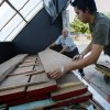 Nick Thomas and Eric Badaroux unload a solar kiln used to dry wood outside the University of Oklahoma College of Architecture Model Shop, which environmentally supplies College of Architecture students the wood and other materials needed for their furniture designs in Norman, Okla. on Wednesday, Aug. 5, 2009. Photo by Steve Sisney, The Oklahoman