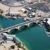Photo - FILE - In this June 3, 2009 file photo, provided Courtesy of the Lake Havasu City Convention and Visitors Bureau, shows London Bridge, which spans the Colorado River at Lake Havasu City, Ariz. The London Bridge is not falling down, despite a British tabloid saying that the Lake Havasu City tourist attraction is being bulldozed to make way for drug tourism. Lake Havasu City officials heard about the story in The Sun after a local resident visiting the United Kingdom brought back a copy of the tabloid. They say it was a slap in the face and demanded a retraction and an apology. (AP Photo/Courtesy of the Lake Havasu City Convention and Visitors Bureau)