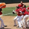 The Redhawks\' prepare to pour water on Matt Duffy, center after driving in the winning run during their game against the Salt Lake Bees at the Chickasaw Bricktown Ballpark in Oklahoma City, Wednesday June 11, 2014. Photo By Steve Gooch, The Oklahoman