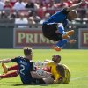Photo - San Jose Earthquakes' Brandon Barklage vaults goalkeeper Jon Busch, right,  as he smothers the ball as Toronto FC's Luke Moore, center,  tries to convert a rebound under pressure from San Jose's Ty Harden during first half MLS action in Toronto on Saturday June 7, 2014.  (AP Photo/The Canadian Press, Chris Young)