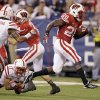 Wisconsin running back Montee Ball (28) runs out of the tackle attempt by Nebraska cornerback Ciante Evans (17) on a 9-yard touchdown run during the second half of the Big Ten championship NCAA college football game Saturday, Dec. 1, 2012, in Indianapolis. (AP Photo/Michael Conroy)