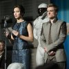 Photo - This film publicity image released by Lionsgate shows Jennifer Lawrence as Katniss Everdeen, left, and Josh Hutcherson as Peeta Mellark in a scene from