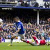 Photo - Everton's Kevin Mirallas, centre left, scores against Arsenal despite the attentions of Mikel Arteta, bottom right,  during their English Premier League soccer match at Goodison Park Stadium, Liverpool, England, Sunday April 6, 2014. (AP Photo/Jon Super)