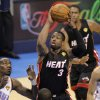 Miami\'s Dwyane Wade (3) shoots over Oklahoma City\'s Serge Ibaka (9) during Game 2 of the NBA Finals between the Oklahoma City Thunder and the Miami Heat at Chesapeake Energy Arena in Oklahoma City, Thursday, June 14, 2012. Photo by Chris Landsberger, The Oklahoman