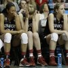 Photo - Stanford's Erica McCall, Taylor Greenfield and Karlie Samuelson, from left, sit on the bench  during the second half of the semifinal game against Connecticut in the Final Four of the NCAA women's college basketball tournament, Sunday, April 6, 2014, in Nashville, Tenn. Connecticut won 75.56. (AP Photo/Mark Humphrey)