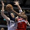 Washington Wizards\' Bradley Beal (3) attempts a shot after getting by Dallas Mavericks\' Chris Kaman (35) in the first half of an NBA basketball game, Wednesday, Nov. 14, 2012, in Dallas. (AP Photo/Tony Gutierrez)