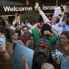 Relatives of new Jewish immigrants from U.S. welcome them as they arrive at the Ben Gurion airport near Tel Aviv, Israel, Tuesday, Aug. 14, 2012. A total of 350 immigrants arrived on the flight from the U.S. Tuesday, and were welcomed by Israel\'s Prime Minister Benjamin Netanyahu in a ceremony at the airport. Over 100 of the new immigrants are expected to join the Israel Defense Forces in the upcoming month. (AP Photo/Oded Balilty)