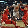 Houston Rockets\' James Harden, center, battles Chicago Bulls\' Kirk Hinrich, right, and Jimmy Butler, left, for a loose ball during the first quarter of an NBA basketball game in Chicago, Tuesday, Dec. 25, 2012. (AP Photo/Paul Beaty)