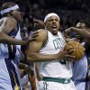 Photo - Boston Celtics small forward Paul Pierce, center, drives to the hoop against Memphis Grizzlies power forward Zach Randolph, left, and guard Tony Allen, right, during the first quarter of an NBA basketball game in Boston, Wednesday, Jan. 2, 2013. (AP Photo/Elise Amendola)