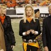 Oklahoma Gov. Brad Henry and his wife Kim Henry at halftime with Madeleine and Boone Pickens during the college football game between the Oklahoma State University Cowboys (OSU) and the University of Texas Longhorns (UT) at Boone Pickens Stadium in Stillwater, Okla., Saturday, Oct. 31, 2009. Photo by Doug Hoke, The Oklahoman