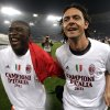 Photo - FILE -- In this file photo taken on May 7, 2011, AC Milan's Clarence Seedorf, left, and  Filippo Inzaghi celebrate after the Serie A soccer match between AS Roma and AC Milan at Rome's Olympic stadium. Real Madrid's Champions League winning coach, Carlo Ancelotti, has backed former player Filippo Inzaghi as the ideal candidate to take over as manager of AC Milan.Current Milan coach Clarence Seedorf is only four months into a 2 ½ year contract, but Italian media reports claim that club owner Silvio Berlusconi has already decided to replace him with the Dutchman's former teammate, Inzaghi. (AP Photo/Pier Paolo Cito)
