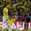 Brazil\'s Marcelo calls to the referee with David Luiz (4) as Neymar lies on the ground after being injured during the World Cup quarterfinal soccer match between Brazil and Colombia at the Arena Castelao in Fortaleza, Brazil, Friday, July 4, 2014. Brazil defeated Colombia 2-1 to advance to the semifinals. (AP Photo/Natacha Pisarenko)