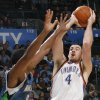 Photo - FIRST REGULAR SEASON WIN: Oklahoma City's Nick Collison shoots over Ryan Gomes of Minnesota during the NBA basketball game between the Oklahoma City Thunder and the Minnesota Timberwolves at the Ford Center in Oklahoma City, Sunday, Nov. 2, 2008. The Thunder won, 88-85. BY NATE BILLINGS, THE OKLAHOMAN  ORG XMIT: KOD