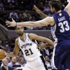 San Antonio Spurs\' Tim Duncan (21) looks to pass around Memphis Grizzlies\' Marc Gasol (33) during the second quarter of an NBA basketball game, Wednesday, Jan. 16, 2013, in San Antonio. (AP Photo/Eric Gay)