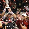 Oklahoma\'s Trevor Knight (9) holds up the MVP trophy as the Sooners celebrate the 45-31 win over Alabama during the NCAA football BCS Sugar Bowl game between the University of Oklahoma Sooners (OU) and the University of Alabama Crimson Tide (UA) at the Superdome in New Orleans, La., Thursday, Jan. 2, 2014. .Photo by Chris Landsberger, The Oklahoman