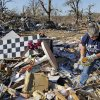 Tammie Rose searches for items to salvage from the destroyed mobile home in which her daughter, Shawna Inlow, used to live in Lone Grove, Okla., Wednesday, February 11, 2009. On Tuesday, February 10, 2009, a tornado moved through Lone Grove killing at least eight people. Inlow and her three boys were able to ride out the storm safely in Rose\'s cellar. BY NATE BILLINGS, THE OKLAHOMAN