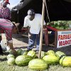 Isidro Ibarra picks out a watermelon with the help of Dinky Tillman, upper left, and Jimmie Abraham II, right, at the East Side Farmers Market, 2630 NE 23rd, in Oklahoma City, Saturday, July 21, 2007. By Nate Billings, The Oklahoman