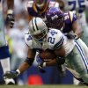 Photo - Dallas Cowboys running back Marion Barber (24) is tackled by Minnesota Vikings defensive end Ray Edwards (91) after a run in the third quarter in their NFL football game, Sunday, Oct. 21, 2007, in Irving, Texas. (AP Photo/Mike Stone) ORG XMIT: IRV120