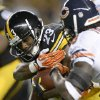 Photo - Pittsburgh Steelers running back Felix Jones (23) tries to run past Chicago Bears cornerback Charles Tillman, right, in the second quarter of an NFL football game on Sunday, Sept. 22, 2013, in Pittsburgh. (AP Photo/Don Wright)