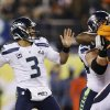 Seattle Seahawks\' Russell Wilson (3) throws against the Denver Broncos during the first half of the NFL Super Bowl XLVIII football game Sunday, Feb. 2, 2014, in East Rutherford, N.J. (AP Photo/Julio Cortez)