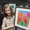 Russell Dougherty fifth-grader Olivia Scott poses with her first place-winning tree art at Edmond\'s celebration of Arbor Week at the Edmond Library, March 26, 2012. Photo By David McDaniel/The Oklahoman