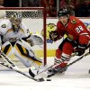 Photo - Chicago Blackhawks' Ben Smith (28) battles for the puck against Nashville Predators' Craig Smith (15) as  goalie Pekka Rinne (35) looks on during the second period of an NHL hockey game in Chicago, Sunday, March 23, 2014. (AP Photo/Nam Y. Huh)