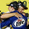 Photo -   Brad Keselowski hugs owner Roger Penske after winning the NASCAR Sprint Cup Series championship following an auto race at Homestead-Miami Speedway, Sunday, Nov. 18, 2012, in Homestead, Fla. (AP Photo/Terry Renna)