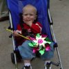 Palmer Freeman enjoys a pinwheel from May Fair, Sunday in Norman. Community Photo By: Jenna McIntosh Submitted By: Jenna,
