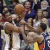 Utah Jazz\'s Derrick Favors, left, is fouled by Atlanta Hawks\' Jeff Teague (0) during the second quarter of an NBA basketball game Wednesday, Feb. 27, 2013, in Salt Lake City. (AP Photo/Rick Bowmer)