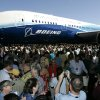 FILE - In this July 8, 2007, file photo, visitors look at and take photos of the first production model of the new Boeing 787 airplane after it was unveiled to an audience of several thousand at Boeing\'s assembly plant in Everett, Wash. The Boeing 787 was a plane that promised to be lighter and more technologically advanced than any other, but once production started, the gap between vision and reality quickly widened. The jet that was eventually dubbed the Dreamliner became plagued with manufacturing delays, cost overruns and sinking worker morale. (AP Photo/Ted S. Warren, File)