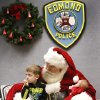 Santa stopped by the Edmond police station Saturday, Dec. 22, 2012, to visit with children, hear their Christmas lists and pose for keepsake photos that were provided for the children by Edmond police department. Sitting on his lap is Jackson Rocamontes, 3, and his baby sister, Arya, 7 weeks old. Playing Santa is Boyd Mize, a retired detective with the Edmond police department. This is the eighth year Mize has donned the Santa suit for the police department\'s day with Santa. But Mize said this is the first year he didn\'t have to wear a fake beard; all the hair on Santa\'s face is natural this year. Photo by Jim Beckel, The Oklahoman