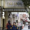 Judy Lim walks with her dog Blitz past the Cecil Hotel in Los Angeles Thursday, Feb. 21, 2013. Canadian tourist Elisa Lam had been missing for about two weeks when officials at the Cecil Hotel found her body in a water cistern on the hotel roof. Guest complaints about low water pressure prompted a maintenance worker to make the gruesome discovery Tuesday, and officials were trying to determine if the 21-year-old was killed or if her death was a bizarre accident. (AP Photo/Damian Dovarganes)