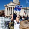 Noah Gosney, 5, gets help with his sign from his dad, James Gosney, who brought Noah and his brother to the rally. They live in Stillwater. The elder Gosney said he\'s been very interested in Paul\'s campaign for about six months. About 1,300 enthusiastic supporters rallied on the Capitol\'s south steps to hear and cheer comments by Republican presidential candidate Ron Paul during a brief visit to Oklahoma City on Saturday, Feb. 25, 2012. Photo by Jim Beckel, The Oklahoman