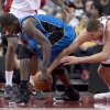 Orlando Magic forward Andrew Nicholson, left, and Toronto Raptors centre Jonas Valanciunas battle for the ball during first half NBA action in Toronto Friday, Dec. 21, 2012. Valanciunas hurt his hand on the play and left the game. (AP Photo/The Canadian Press, Frank Gunn)