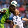 Seattle Sounders\' Jhon Kennedy Hurtado, left, heads the ball above Vancouver Whitecaps\' Kenny Miller, of Scotland, during the first half of an MLS soccer match in Vancouver, British Columbia, on Saturday, July 6, 2013. (AP Photo/The Canadian Press, Darryl Dyck)