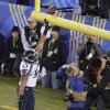 Seattle Seahawks\' Malcolm Smith (53) celebrates after returning intercepting a pass for a touchdown during the first half of the NFL Super Bowl XLVIII football game against the Denver Broncos Sunday, Feb. 2, 2014, in East Rutherford, N.J. (AP Photo/Charlie Riedel)